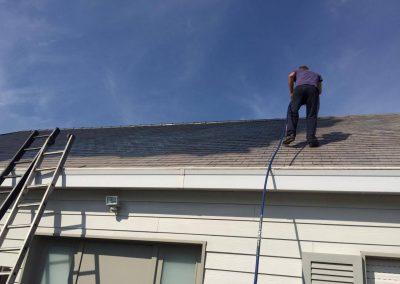 Ontmossen dak tijdens 2